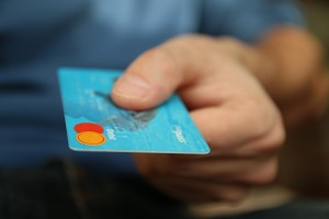 Manage the risks of issuing retail credit cards by monitoring retailers' practices.